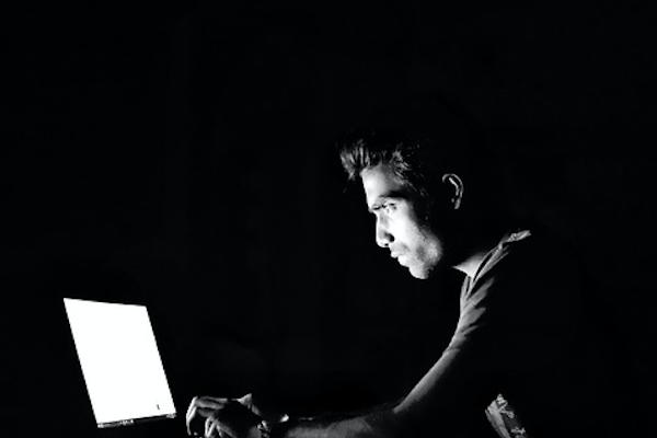 Man watching laptop